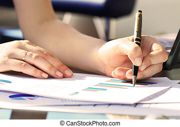 Business Woman Writing with pen in the office