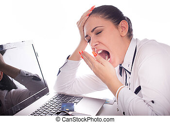 Business woman yawning above laptop