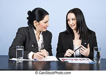 Business women conversation at meeting