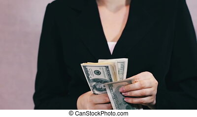 Business Women Counts Money in Hands.