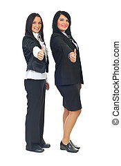 Business women giving thumbs