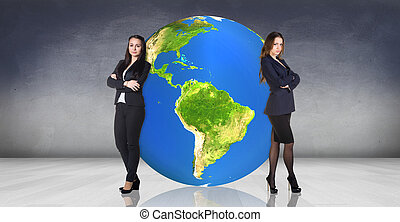 Business women recline on the big earth