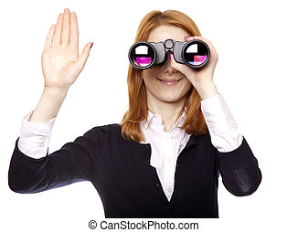 Business women seeking with binocular and show right hand. Studio shot.