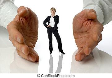 business women standing between male hands concept