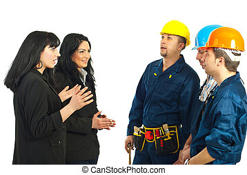 Business women talking with workers men