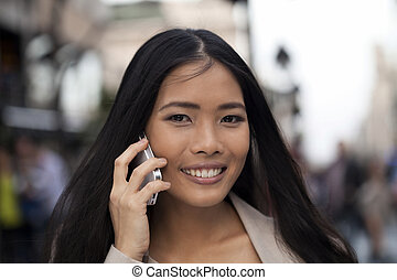 Business women using smart phone outdoor