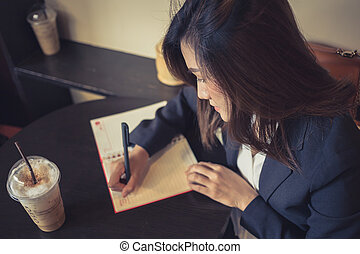 business women working writing in the cafe