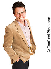 Businessman standing with hands in his pocket. Smiling.