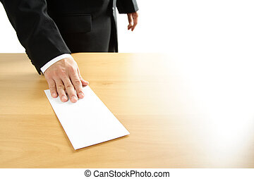 Businessman - A businessman handing in a blank envelope