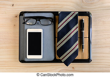 Businessman accessories and notebook bag on desk