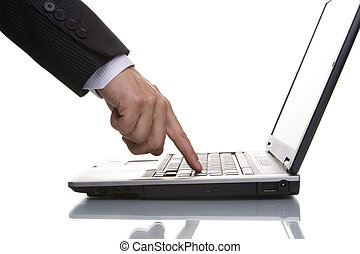 businessman pressing the enter key on a laptop