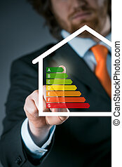 Businessman activating an energy efficiency chart