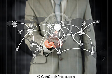 Businessman activating futuristic touchscreen against a black background