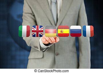 Businessman activating German flag on touchscreen against a blue background