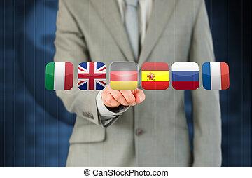 Businessman activating German flag - Businessman activating...