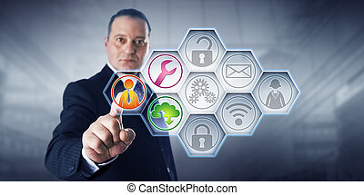 Confident business director is activating three managed services icons by touch on a control screen. The remaining six of nine IT buttons remain gray. Concept for efficiency through managed services.