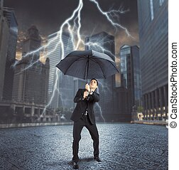 Businessman against lightning - Businessman is repaired by...