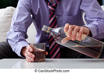 Businessman alcoholic - Businessman in middle age drinking...