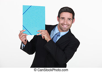 businessman all smiles holding file