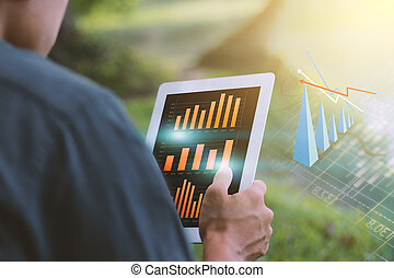 Businessman analysis financial paperwork and reports, graph, planning
