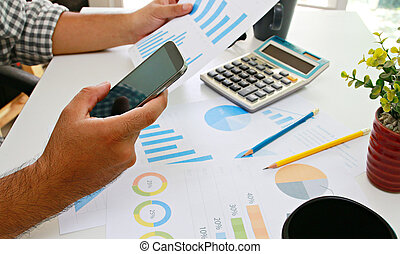 Businessman analysis financial paperwork and reports, graph, planning, working at office desk.