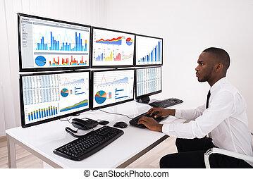 Businessman Analyzing Financial Chart On Computer