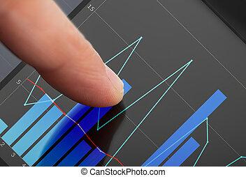 Businessman Analyzing Graphs On Digital Tablet