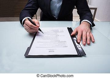 Businessman Analyzing Resume