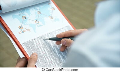Businessman Analyzing Start Up Report