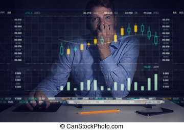 businessman analyzing stock market graphs and data on computer screen