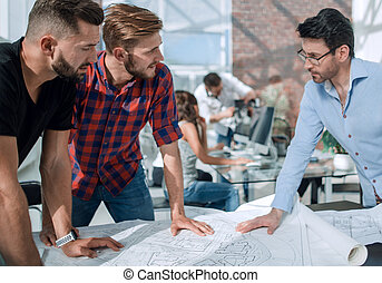 businessman and a group of architects discussing a new project