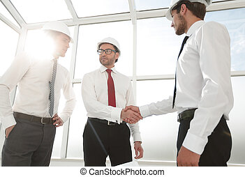 businessman and architect shaking hands