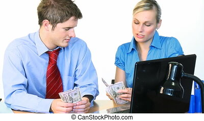 Businessman and businesswoman counting dollars