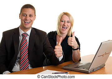 Businessman and businesswoman expressing success