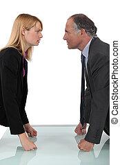 businessman and businesswoman having a quarrel