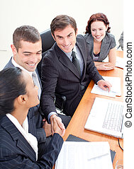 Businessman and businesswoman in a meeting shaking hands