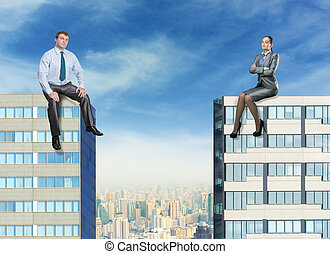 Businessman and businesswoman on the buildings