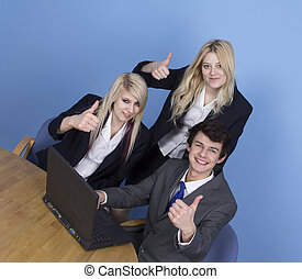 Businessman And Businesswoman Showing Thumb Up