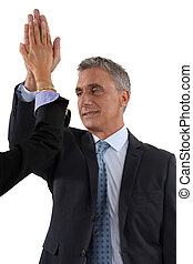 businessman and businesswoman touching hands