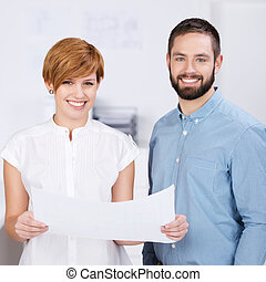 Businessman And Businesswoman With Paper