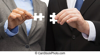 businessman and businesswoman with puzzle pieces - business ...