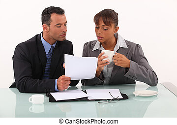 businessman and businesswoman working and drinking coffee