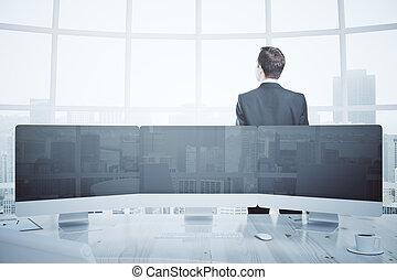 Businessman and digital panel