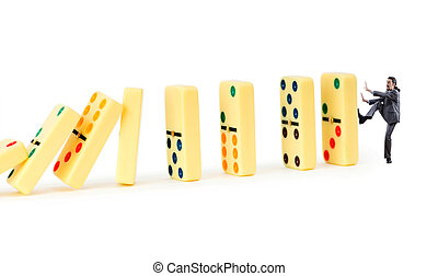 Businessman and dominoes isolated on the white