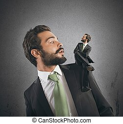 Businessman and his conscience - Businessman with small...