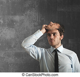 Businessman and mask - Businessman takes off the mask which...
