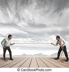Businessman and rope challenge - Businessman and pull the...