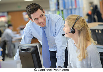 businessman and smiling secretary talking by phone