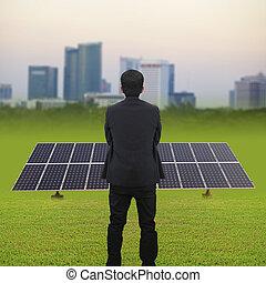 Businessman and Solar energy plants