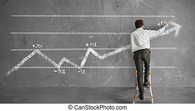 Businessman and statistics trend - Businessman draws a...